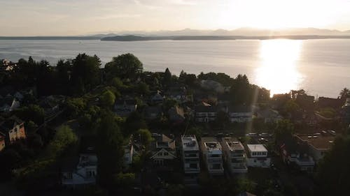 West Seattle Aerial View Of Residential Neighborhood Houses With Ocean And Mountains Background