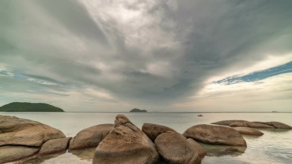 Thumbnail for Beautiful clouds on the background of rocky stones and sea landscape