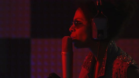 Thumbnail for Woman Singing in Recording Booth
