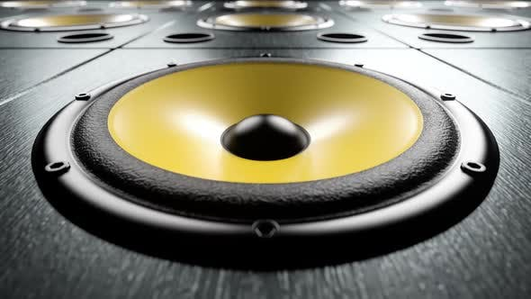 Thumbnail for Close-up of Audio Speaker with Yellow Membrane Playing Rhythmic Music Loop