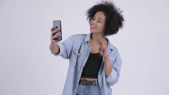 Cover Image for Young Happy African Woman Taking Selfie
