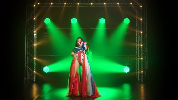 Thumbnail for Chic Girl Dancing in a Sexy Suit in the Color of the English Flag and Rhinestones, Attractive