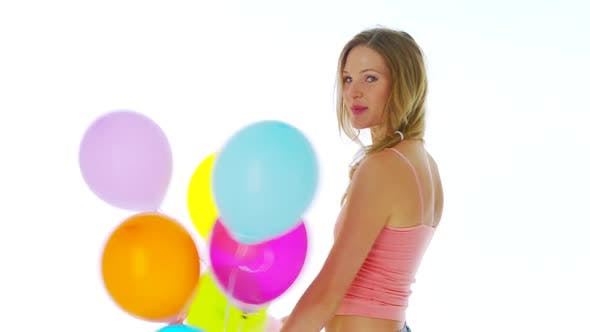 Thumbnail for Woman standing with balloons