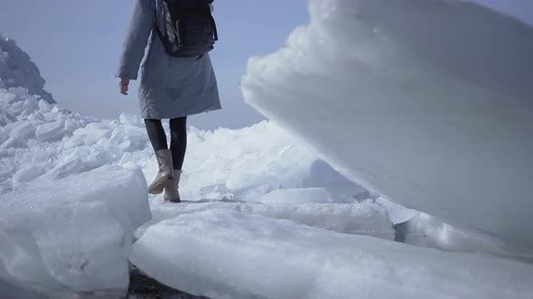 Thumbnail for Young Woman in Warm Jacket Walking on the Glacier