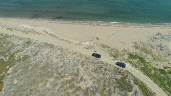 Drone Following Slow Driving Cars at the Beach in Lemnos, Greece