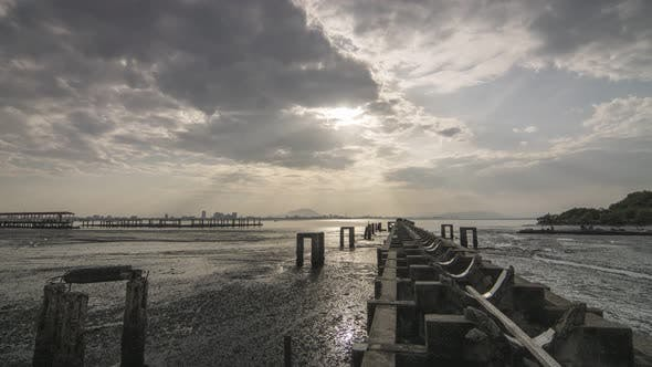 Timelapse of Broken Bridge jetty sunrise with amazing ray and cloud