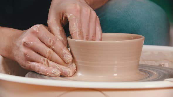Thumbnail for Pottery - the Master Is Raising the Walls of the Clay Bowl with His Hands on the Potter's Wheel in