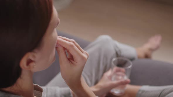 Thumbnail for Woman Taking Omega 3 Fish Oil Pill and Drinking Water