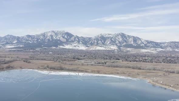 Thumbnail for Boulder Colorado Establishing Aerial Winter Landscape Lake Mountains Road