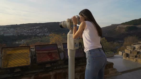 Thumbnail for Female Tourist, Brunette Girl with White Shirt Watching the Panoramic View with Binocular. Tsarevets