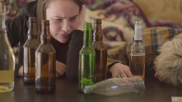 Thumbnail for Bad Looking Teens Lying on the Table Near Empty Alcohol Bottles