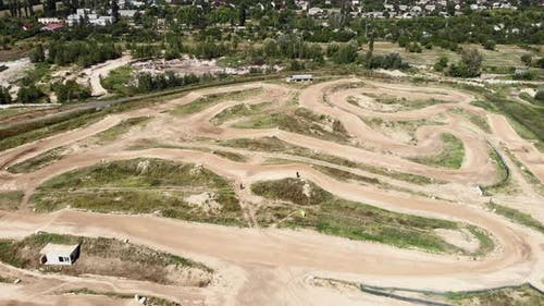 Professional motorbike motorcycle race track with enclosed dirt circuits with steep obstacles