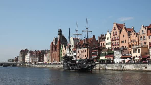 Thumbnail for Waterfront with Historical Terraced Houses, Stylized Old Ship Sailing on River