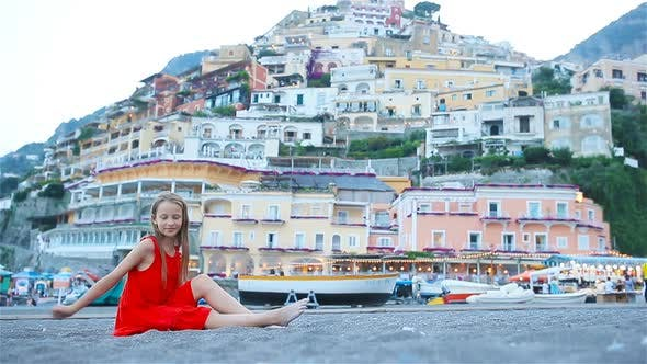 Thumbnail for Adorable Little Girl on Warm and Sunny Summer Day in Positano Town in Italy