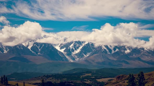 Thumbnail for Clouds covering the snow-capped peaks of high mountains