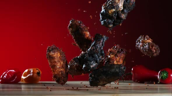 Thumbnail for Smoked chicken wings falling and bouncing in ultra slow motion 1500fps - CHICKEN WINGS PHANTOM