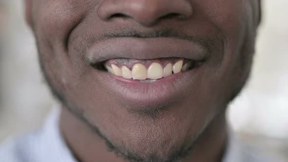 Thumbnail for Close Up of Smiling African Man Lips