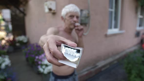 Thumbnail for Addicted Man Offers a Cigarette