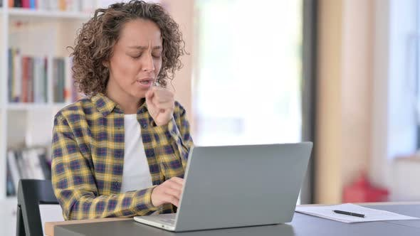 Young Mixed Race Woman with Laptop at Work Coughing