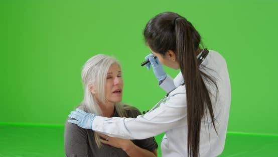 Thumbnail for An older woman gets help for her sickness on green screen