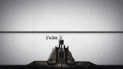 Words Fake News written by a typewriter