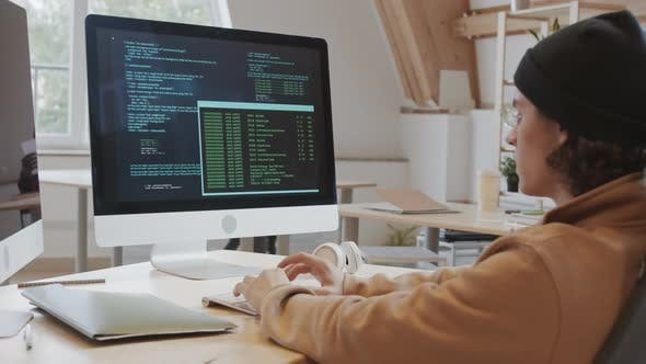 Caucasian Man Developing Software in Office