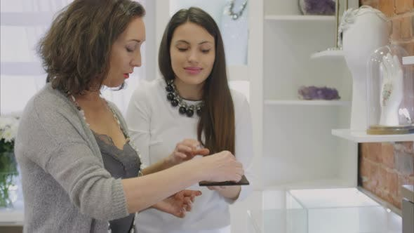 Thumbnail for The Woman Chooses Earrings in the Jewelry Store
