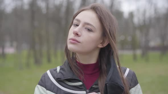 Thumbnail for Portrait of Brunette Girl Taking Off Protective Mask and Touching Face