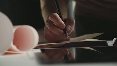 Men's Hands Write in the Diary, Take Notes and Write To the Organizer
