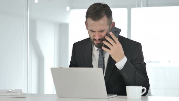 Cover Image for Angry Businessman Yelling on Phone, Financial Loss