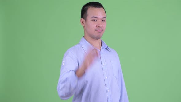 Thumbnail for Studio Shot of Happy Asian Businessman with Ok Sign