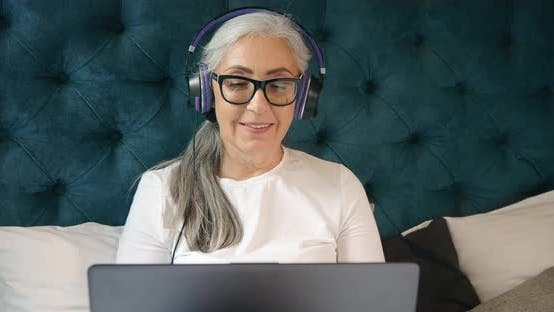 Thumbnail for Elderly Woman with Laptop Singing