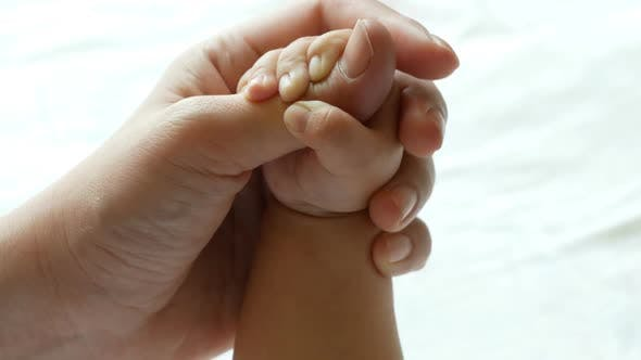 Thumbnail for Newborn Baby Touching Mother Hand