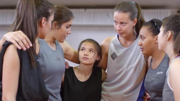 Thumbnail for Female Basketball Team Huddling and Listening to Leader