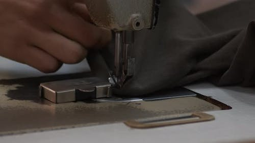 Tailor Sews Trousers On The Sewing Machine 3
