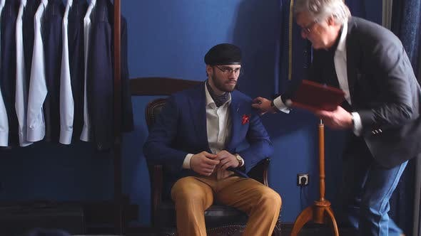 Thumbnail for Mature Professional Tailor Taking Measure Leg Measuring of Client Customer