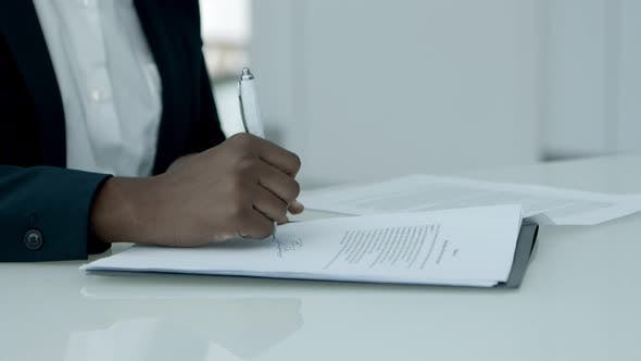 Thumbnail for Businesswoman Signing Papers