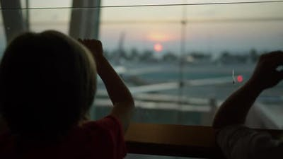 Child Standing Near the Window at the Airport