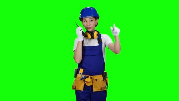 Thumbnail for Engineer Girl Wearing Glasses and Wearing Talks on the Walkie Talkie, Green Screen