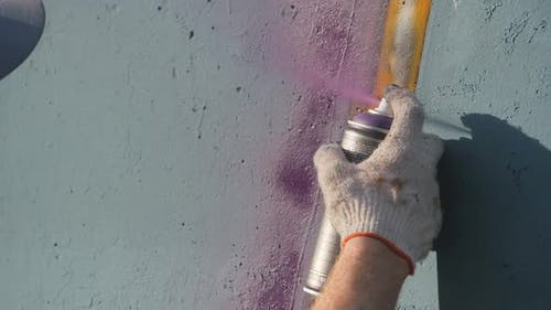 Artistic painting of walls on the street. Graffiti.