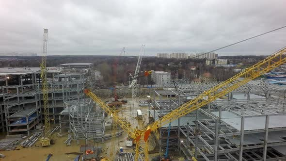 Thumbnail for An Aerial View of a Huge Construction Site Against the Bare Forest and Dull Sky