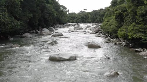 Tropical river in the Andes of Ecuador with large boulders