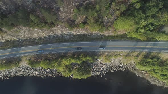 Thumbnail for Cars Are Going on Country Road Near Lake in Norway in Summer Day. Aerial Vertical Top-Down View