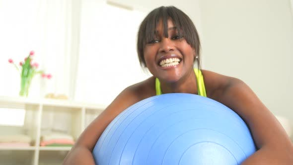Thumbnail for Happy and healthy black woman smiling on exercise ball