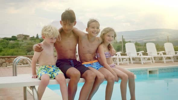 Thumbnail for Four Happy Kids Swaying by the Pool Side