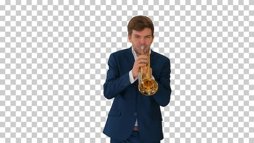 Young man in suit playing a trumpet while walking, Alpha Channel