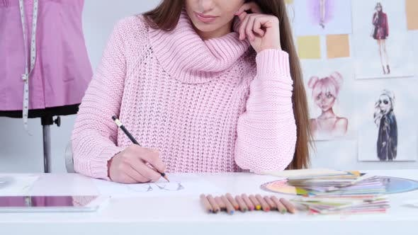 Thumbnail for Dress Designer Creates Beautiful Drawings with Pencils in His Workshop. Close Up