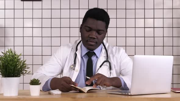 Thumbnail for African American Doctor Making Notes