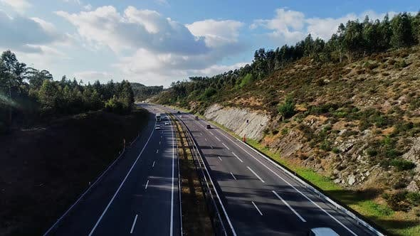 Thumbnail for Aerial Shot of a Bridge with Traffic on it. Footage is Made in the Rural Area with Pine Trees