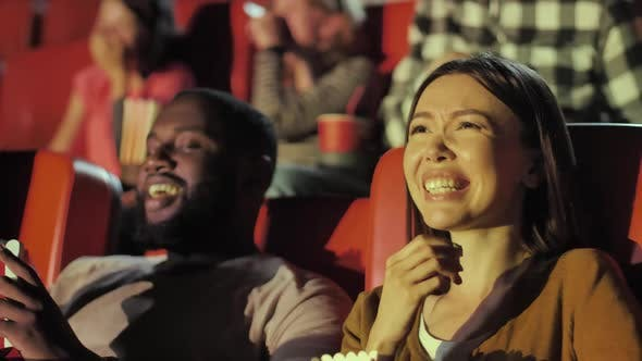 Audience Laughing at Movie Theater